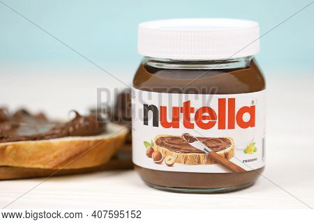 Kharkov, Ukraine - December 27, 2020: Nutella Glass Can And Spread On Freshly Baked Bread. Nutella I