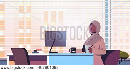 Black Muslim Businesswoman Sitting At Workplace And Using Computer Arab Businesswoman Working In Off