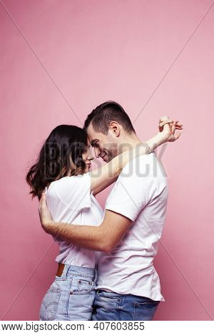 Young Cheerful Caucasian Couple Together Having Fun On Pink Background, Guy Ang Girl Modern Relation