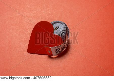 Soft Measuring Tape.  Tape Measure With Metric Scale. Measuring Tape Around Heart