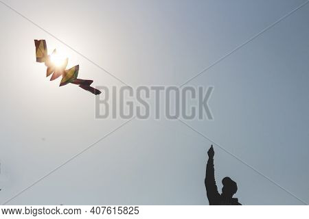 Silhouette Of A Person Flying A Kite