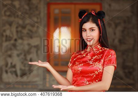 Beautiful Asian Woman In Red Chinese Dress Traditional Cheongsam Qipao With Gesture Of Introduce Or
