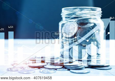 Coins In The Glass. Saving Money For Finance Accounting.  Financial Investment With Graph Background