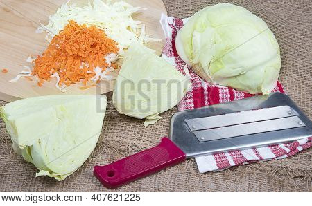 Сhopping Knife And Chopped Cabbage On Cutting Board, Burlap Background