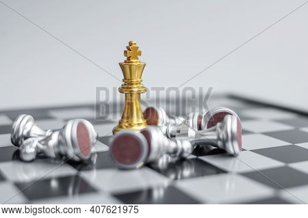 Gold Chess King Figure Stand Out From Crowd Of Enermy Or Opponent During Chessboard Competition. Str