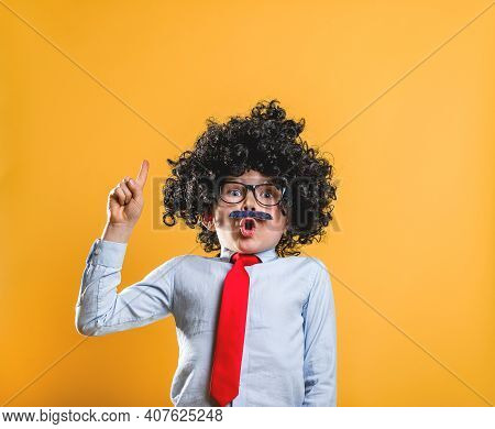 Genius Indigo Kid. Portrait Of Stylish Little Child Boy With Strong Muscles Isolated On Yellow. Go B