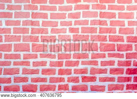 Red Graffitti Painted Different Sized Brick Wall Background.