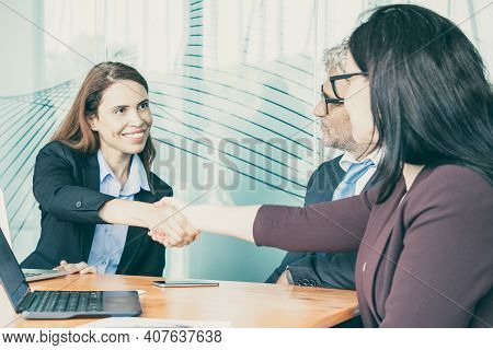 Red-haired Hr Manager Greeting Employee In Conference Room. Successful Ceo And Businesswoman Intervi