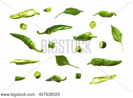 Green Fresh Pieces And Whole Chili Pepper, Leaves Isolated On White Background. Seasoning For Dish,