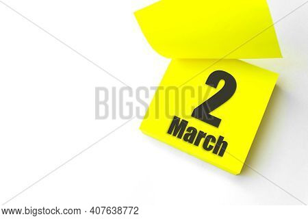 March 2nd. Day 2 Of Month, Calendar Date. Close-up Blank Yellow Paper Reminder Sticky Note On White