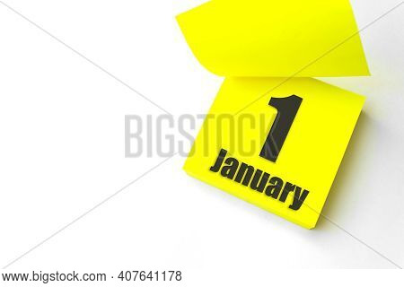 January 1st . Day 1 Of Month, Calendar Date. Close-up Blank Yellow Paper Reminder Sticky Note On Whi
