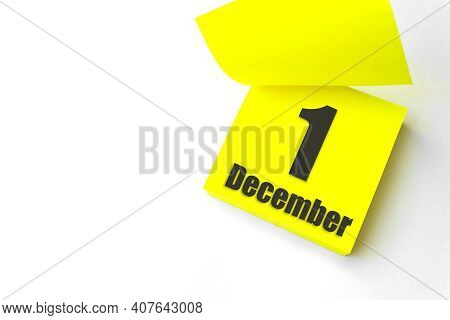 December 1st . Day 1 Of Month, Calendar Date. Close-up Blank Yellow Paper Reminder Sticky Note On Wh
