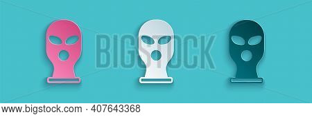 Paper Cut Balaclava Icon Isolated On Blue Background. A Piece Of Clothing For Winter Sports Or A Mas