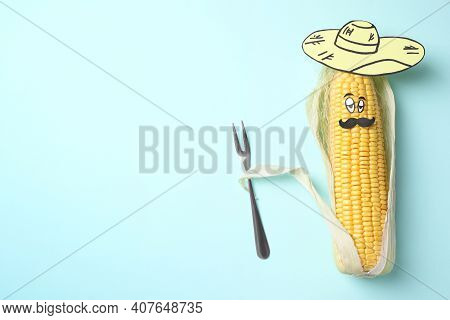 Mexican Man Of Corncob, Paper Hat And Fork On Light Blue Background, Top View. Space For Text