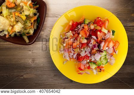 Vegan Food. Salad From Vegetables Pepper, Tomato, Onions, Broccoli On Yellow Plate With Vegetable Sa