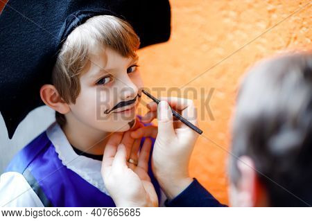 Father Making Face Painting For Little Kid Boy. Child Dress Up For Carnival, Halloween Or Birthday P