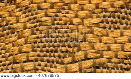 Close-up Background Of Bright Golden Textile Texture