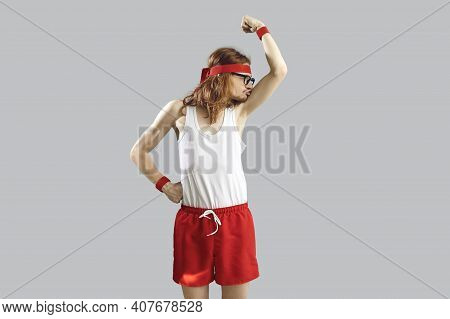 Funny Skinny Nerd In Tank Top And Shorts Kissing Weak Biceps After First Sports Workout