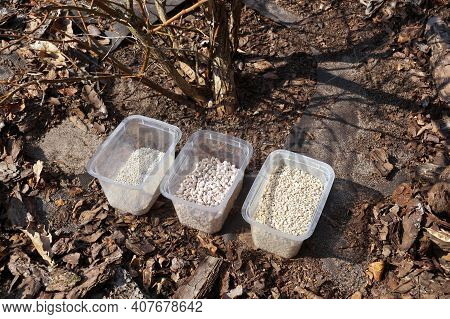 Three Fertilizer Containers, Three Different Types Of Fertilizer. Spring Fertilization Of Plants In
