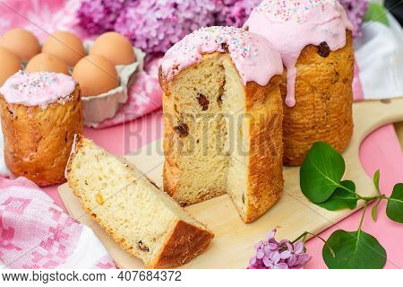 Slavic Orthodox Easter Bread Kulich With Raisins Sultana, Nuts And Pink Icing