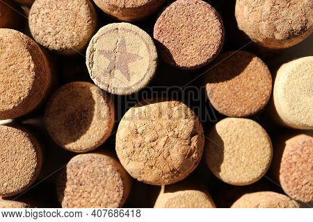 Many Cork Texture Bottle Bungs Together Background. Star Symbol. Numbers 1876.