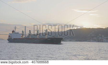Turkey, Istanbul-december, 2020: Ship Off Coast Of Sea City. Action. Steamboat Sails Near Shore Of I