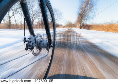 Front Bicycle Wheel Spinning Motion Blur. Bicycling On Slippery Snow