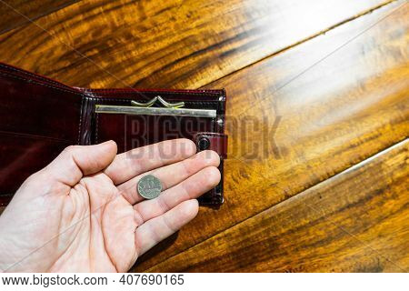 The Hand Of An Adult Holds Russian Five Kopeks Coin In The Palm Of His Hand And Opened Wallet.