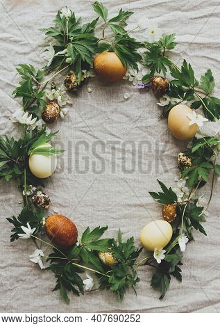 Easter Rustic Wreath Made Of Eggs And Spring Flowers Petals On Rustic Linen Background, Flat Lay Wit
