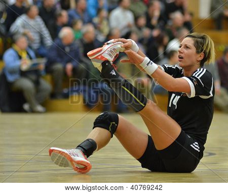 SIOFOK, HUNGARY - JANUARY 5: Annamaria Bogdanovic injured at a Hungarian National Championship handball match Siofok KC (black) vs. Budapest SE (white) January 5, 2013 in Siofok, Hungary.