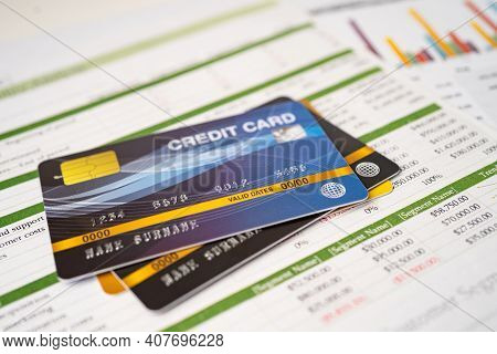 Credit Card On Chart And Graph Spreadsheet Paper. Finance Development, Banking Account, Statistics,