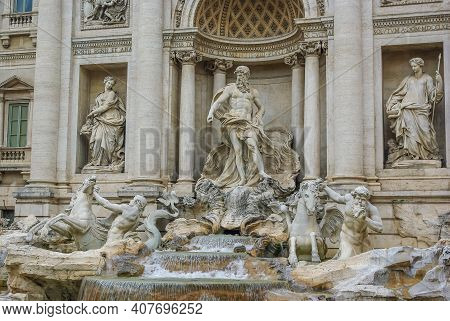 Trevi Fountain In Rome, Italy. Facade And A Close Full View Towards A Famous Baroque Fountain. Watte