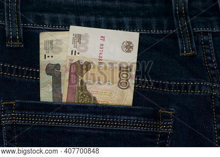 Money In Your Pocket. Russian Rubles. Bills Of 100 And 50 Rubles In A Trouser Pocket. Jeans Pants, M