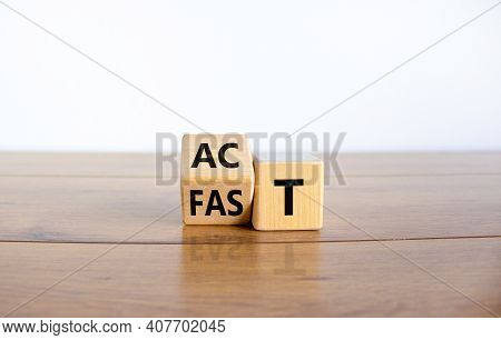Time To Act Fast Symbol. Turned A Wooden Cube With Words 'act Fast'. Beautiful Wooden Table, White B
