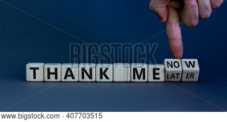 Thank Me Now Or Later Symbol. Businessman Turns Cubes And Changes Words 'thank Me Later' To 'thank M