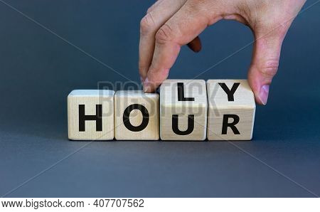 Holy Hour Symbol. Hand Turns Wooden Cubes With Words Holy Hour. Beautiful Grey Background, Copy Spac