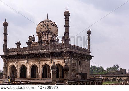Vijayapura, Karnataka, India - November 8, 2013: Ibrahim Rauza Mosque Is Brown Building With Dome An