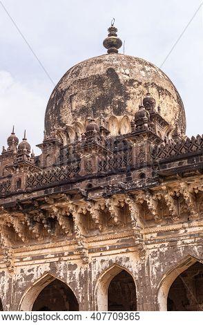 Vijayapura, Karnataka, India - November 8, 2013: Closeup Of Blackened Dome And Decorated Ledge Of Ro