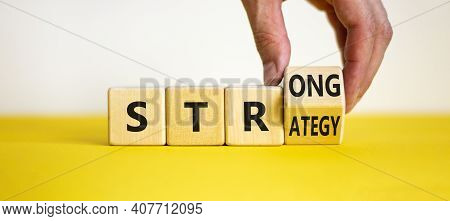 Strong Strategy Symbol. Businessman Turns A Wooden Cube With Words 'strong Strategy'. Beautiful Yell