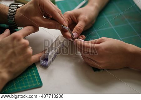 Two Contemporary Working Together In Jewelry Workshop. Master And Apprentice. Young Male Assistant A