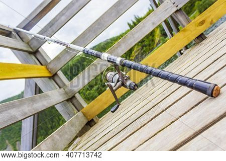 Fishing Rod On A Wooden Pier By The Lake Vangsmjøse In Vang I Valdres Norway.