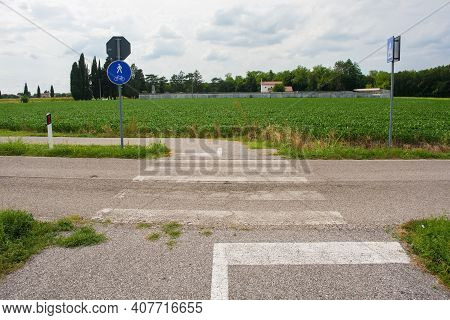A Pedestrian Crossing Where A Road Side Cycle Lane Crosses A Country Road In Friuli-venezia Giulia,