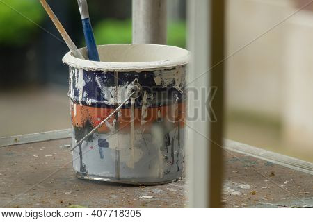 House Renovation. A Bucket Of Paint And A Paint Brush.