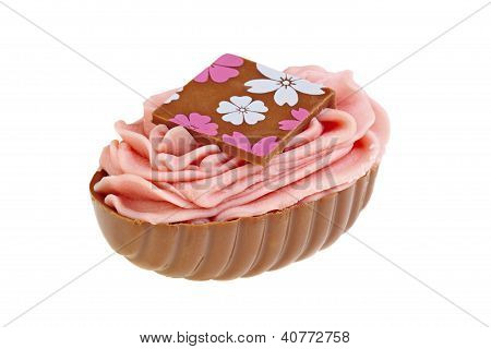 Sweet chocolate bonbon with pink cream  on white background