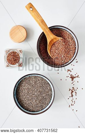 Flax Seeds And Chia Seeds In Bowls, Top View.