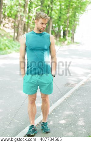 Handsome Sportsman In Sportswear Outdoors. Active Sportsman Training Outdoor. Sportsman Living Healt