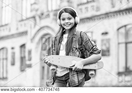 Happy Little Skater Girl Hold Skating Board Listening To Music In Headphones Summer Urban Outdoors,