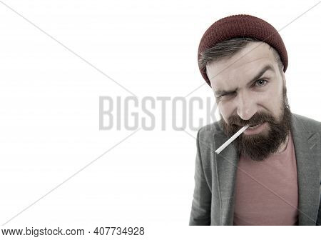 Brutal Unshaven Guy Smoking Isolated White Background. Brutal Habits And Lifestyle Of Tramp. Hipster