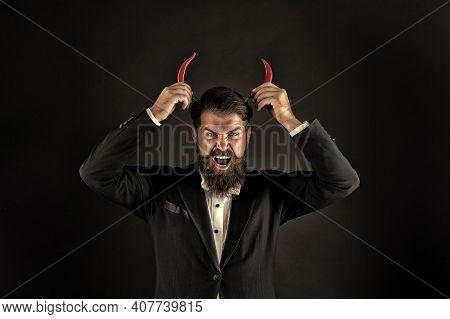 Handsome Macho Likes Taste. Man Hold Pepper Harvest. Red Horns. Devil Inside. Stubborn Bearded Busin