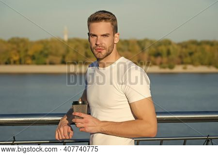 Summer Rest. Place Of Power. Man Hipster Relaxing At Riverside Nature Background. Handsome Guy Outdo